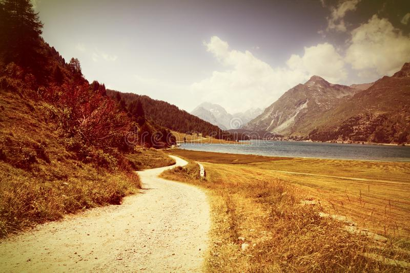 Country road around Sils Lake on upper Engadine Valley Switzerland - Europe - Toned with a retro vintage instagram filter effect.  stock images
