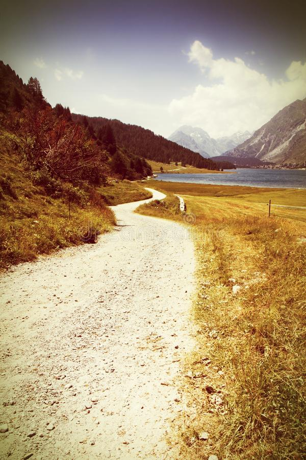 Country road around Sils Lake on upper Engadine Valley Switzerland - Europe - Toned with a retro vintage instagram filter effect.  stock photography