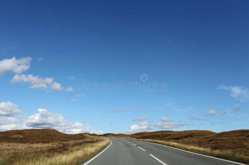 Country road clouds royalty free stock images