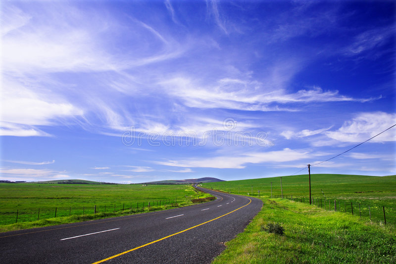 Country road clouds stock images