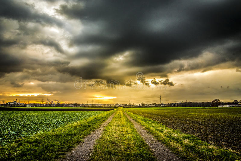 Country road dramatic sky sunset stock photos