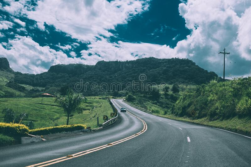 Country road through field royalty free stock image