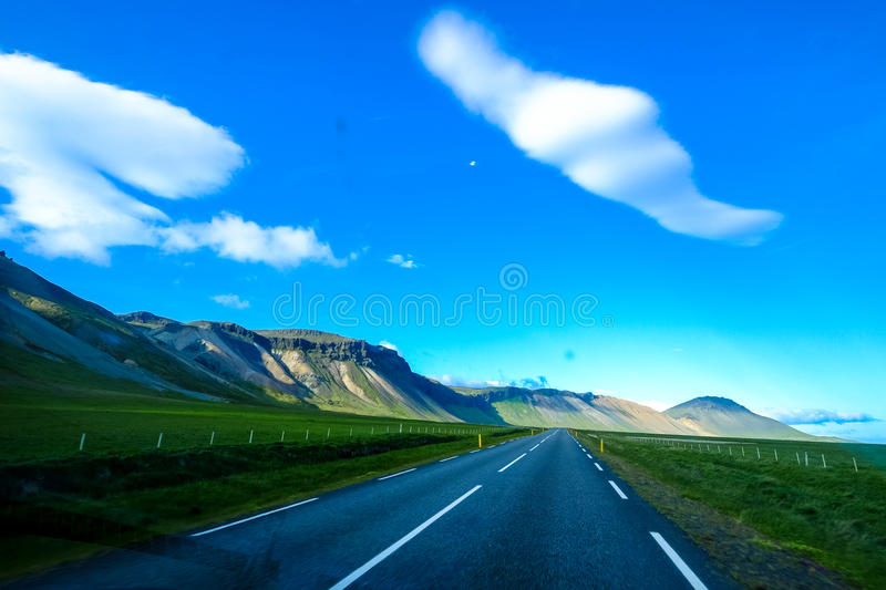 Country road through hillside royalty free stock images