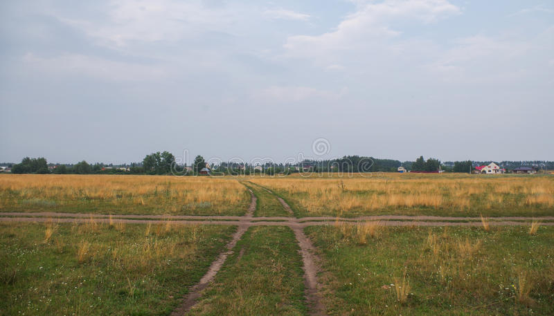 Country road leading up to the horizon line. Nature series stock photography