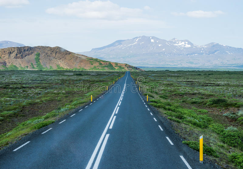 Country road. Lonely country road in Iceland stock photos