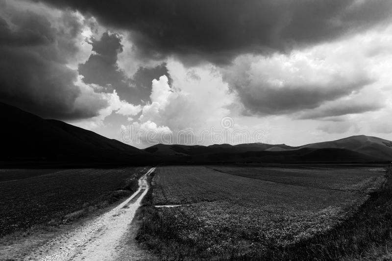Country road and moody sky stock image