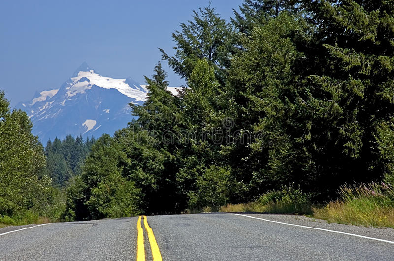 Download Country Road With Mountain In Background Stock Photo - Image of blue, destination: 10383032
