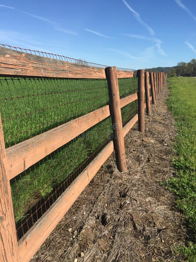 Country road ranch fence royalty free stock photography