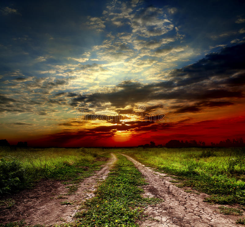 Country road and sunset royalty free stock image