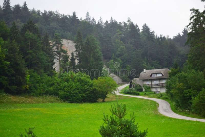 Mountain village road view Slovenia Europe. Country road to Podsmreka pri Višnji Gori village,Municipality of Grosuplje seen from A2 motorway-Dolenjska royalty free stock images