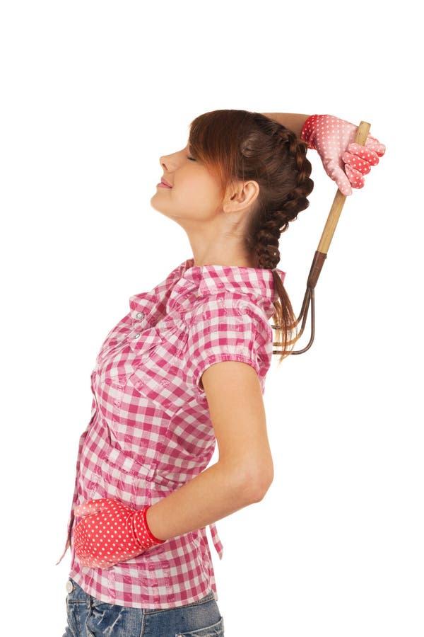 Country seduction. Girl seducing you with rake stock photography