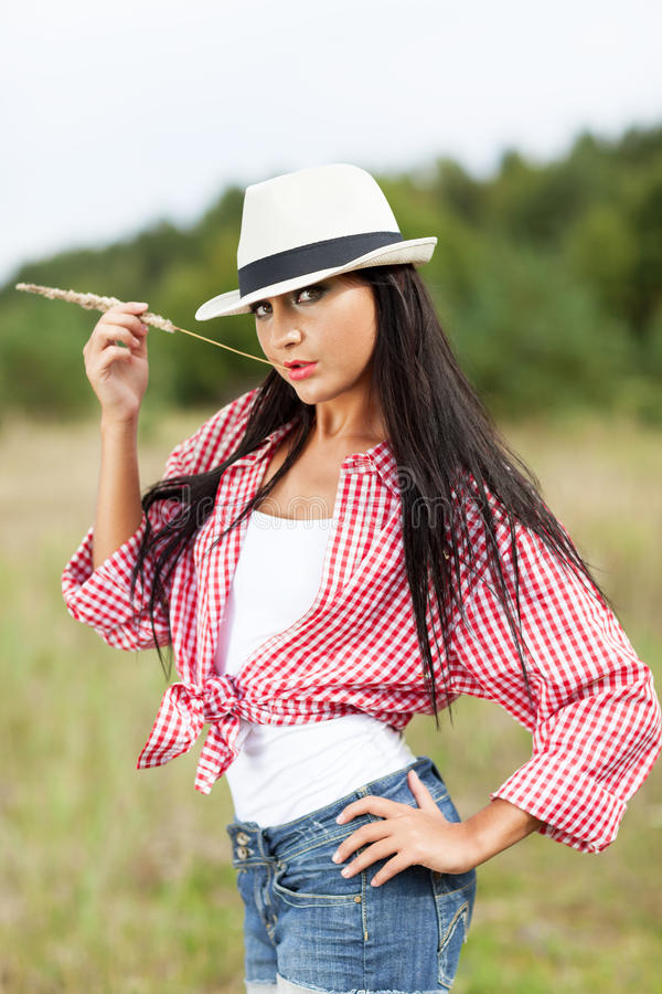 Country seduction. Seductive country girl in the meadow stock photography