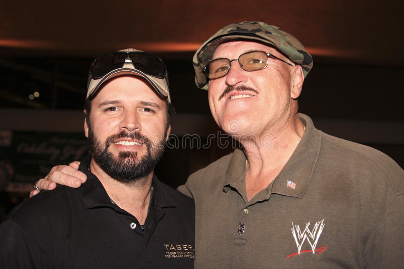 Country singer Mark Wills with WWE Sgt. Slaughter. Country singer, Mark Wills, with WWE's Hall of Fame wrestler Sgt. Slaughter at Taser Foundation charity golf stock photo
