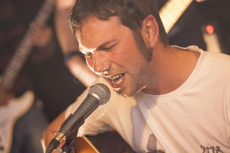 Country singer sings in a bar  4. Country singer sings in a bar under the dim lights royalty free stock images