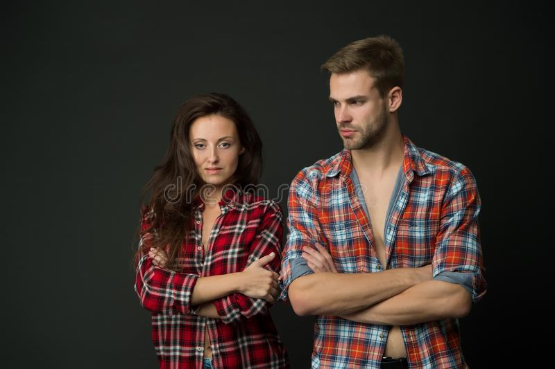 Country style. Woman and man wear checkered shirt. Rustic and country. Sexy people. Youth fashion. Fashionable outfit. Country style. Woman and men wear stock photo