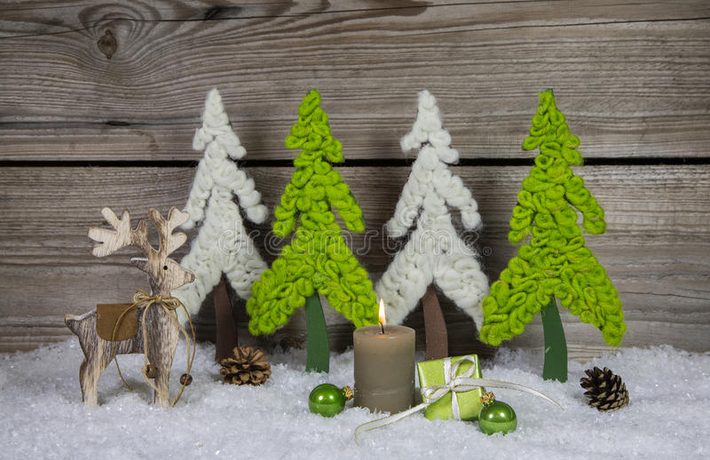 Country style wooden christmas decoration in apple green and white with candle and reindeer. Country style wooden christmas decoration in apple green and white royalty free stock photos