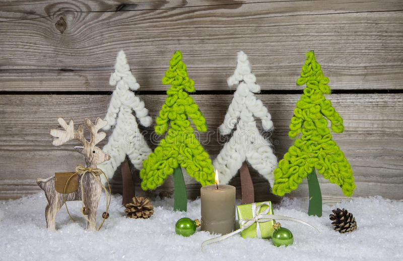 Country style wooden christmas decoration in apple green and whi. Te with candle and moose royalty free stock images