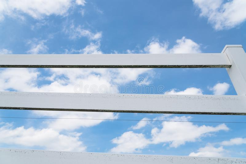 Country style wooden fence against cloud blue sky stock photo