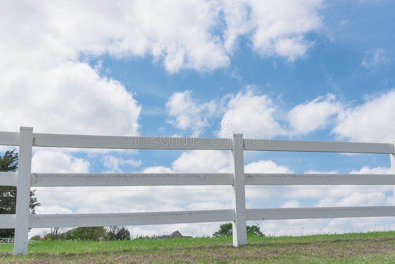 Country style wooden fence against cloud blue sky royalty free stock photo