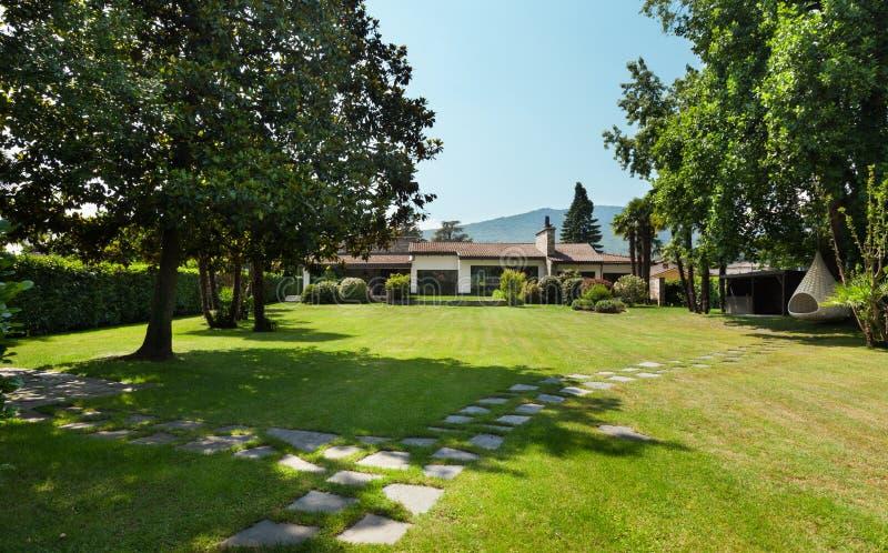 Country villa, garden. Country villa, view from the garden royalty free stock image
