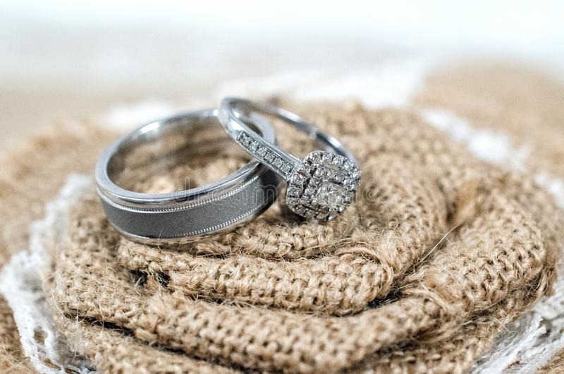 Country wedding bride and groom wedding rings silver bands royalty free stock image