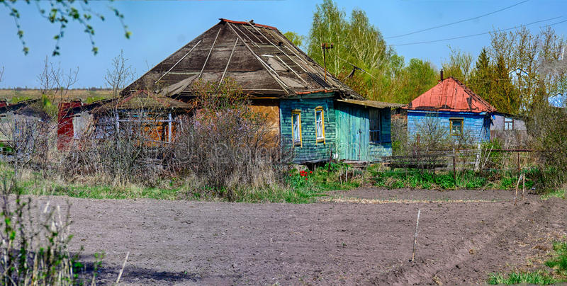Country yard with old house in a village. Summer landscape of a country yard with old house in a village royalty free stock photo