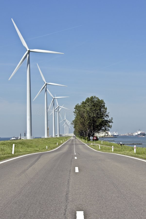 Countryroad And Windmills In The Netherlands Royalty Free Stock Images