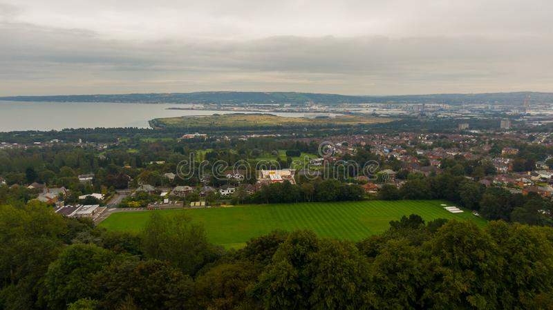Countryside, aerial view on houses near coast of Irish sea in Belfast Northern Ireland. Cloudy sky above seaside.  stock images