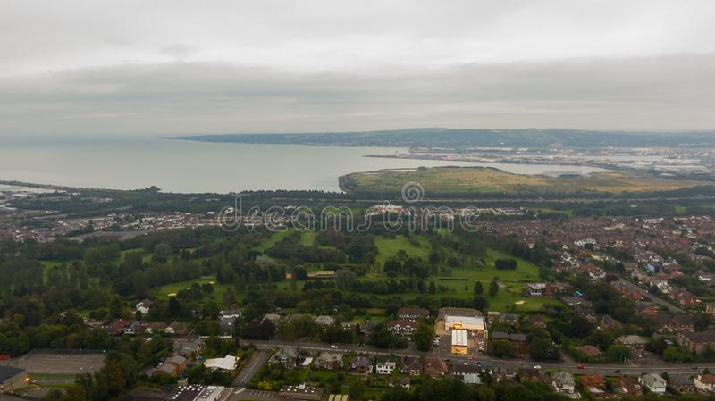 Countryside, aerial view on houses near coast of Irish sea in Belfast Northern Ireland. Cloudy sky above seaside.  stock photography