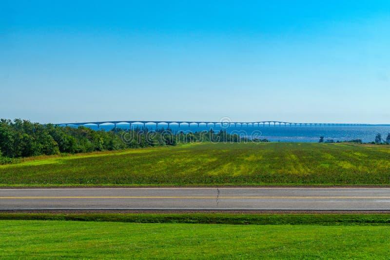Countryside and the Confederation Bridge, PEI. View of countryside and the Confederation Bridge, near North Carleton, Prince Edward Island, Canada stock image