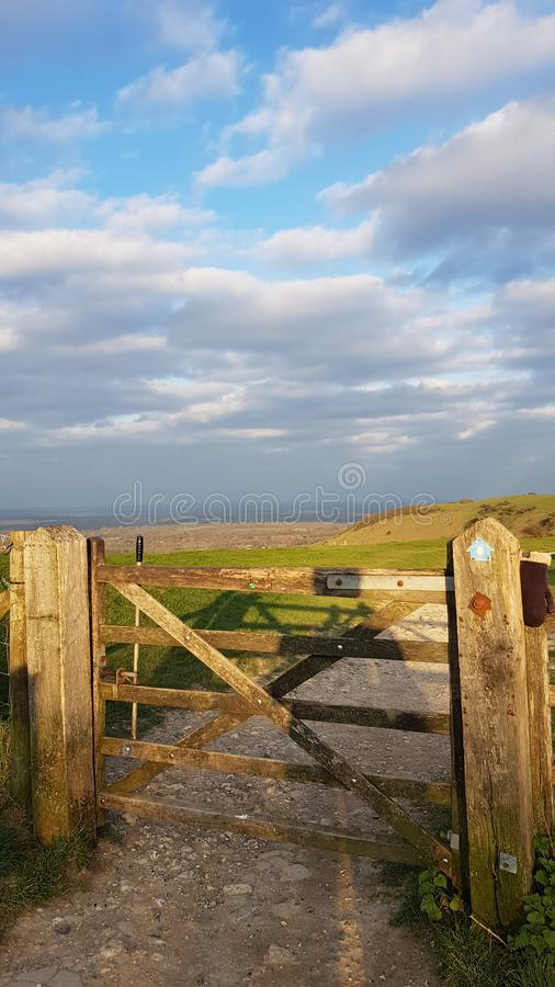 Countryside gate on the Sussex Southdowns in the United Kingdom. Countryside gate sussex southdowns england nobody landscape rambling trail clouds uk spring stock photos