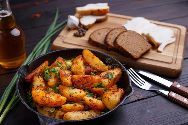 Countryside homemade traditional food, roasted potatoes, bacon, stock photo