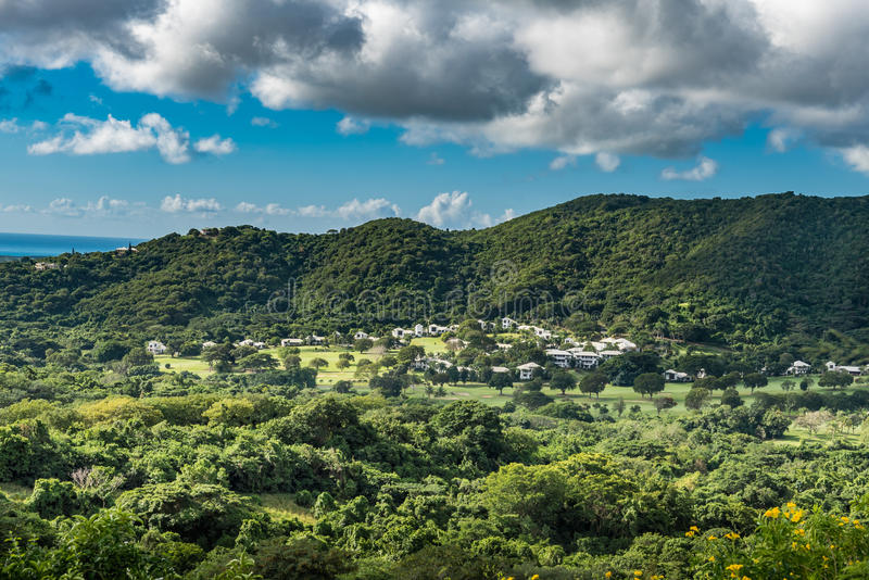 Countryside on the island of St. Croix. Drive through St. Croix along the seaside through the countryside. Small village at the base of the hillside stock photography
