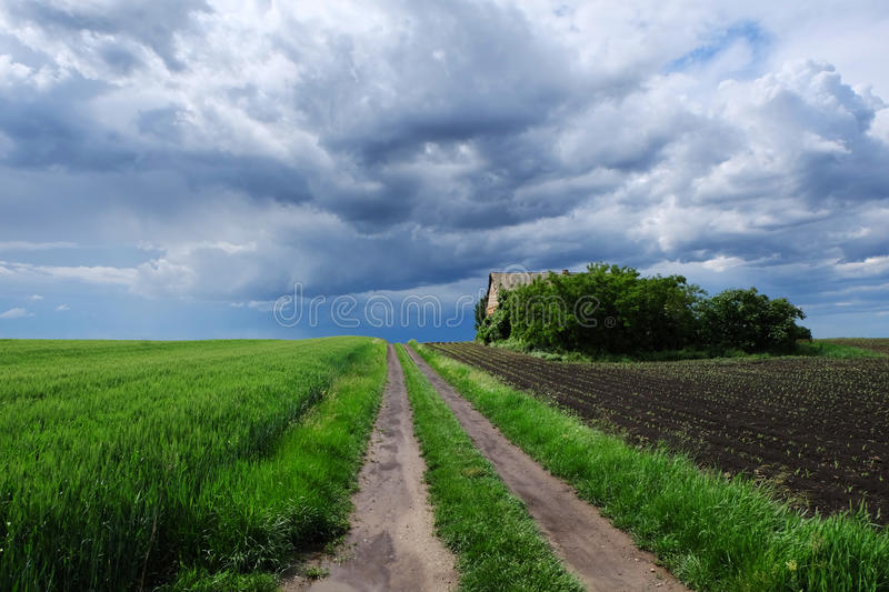 Countryside landscape with abandoned house and stormy sky royalty free stock photography
