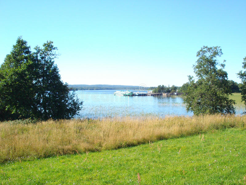 Countryside landscape with lake and ship royalty free stock photos