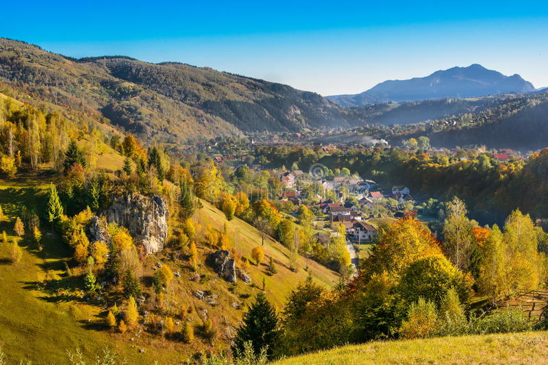 Countryside landscape in Moeciu-Bran, a romanian villlage. Countryside landscape in a romanian villlage at the foot of Piatra Craiului Mountains stock photos