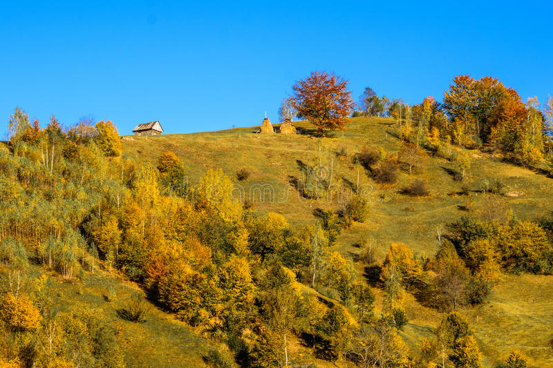 Countryside landscape in a romanian villlage. At the food of Piatra Craiului Mountains stock photo