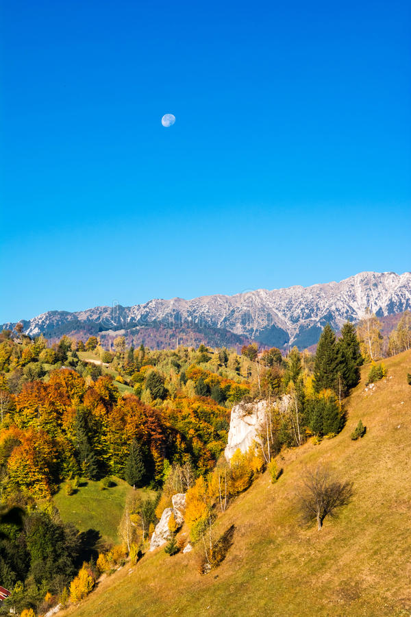 Countryside landscape in a romanian villlage. At the food of Piatra Craiului Mountains stock images