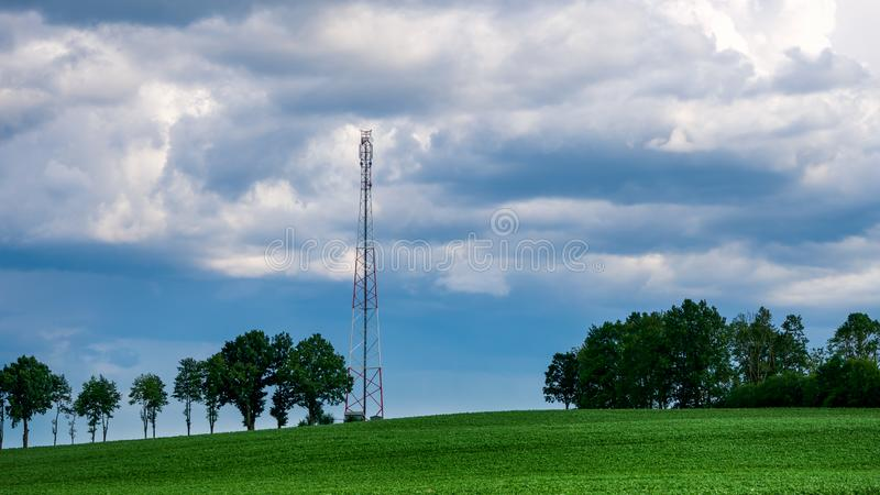Countryside Landscape with straw hay bales on agricultural field, blue sky and power lines.  stock image