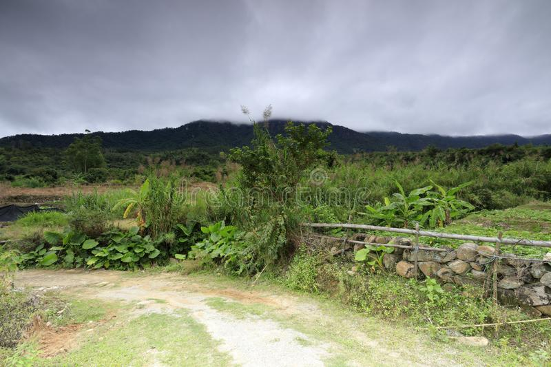 Countryside lane at the foot of the mountain, adobe rgb. Country lanes in neitiancun village of lianhua town, xiamen city, fujian province, china. the mountains royalty free stock image