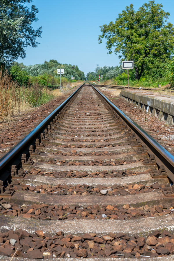 Countryside railroad track in station with platform stock images