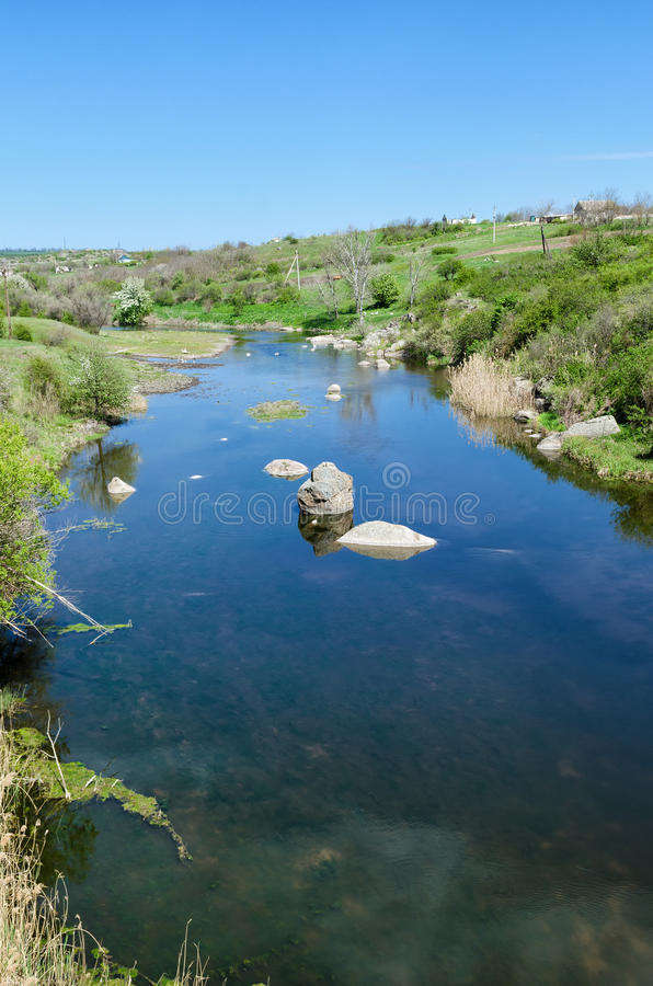 Countryside river landscape in early spring season.  royalty free stock photography