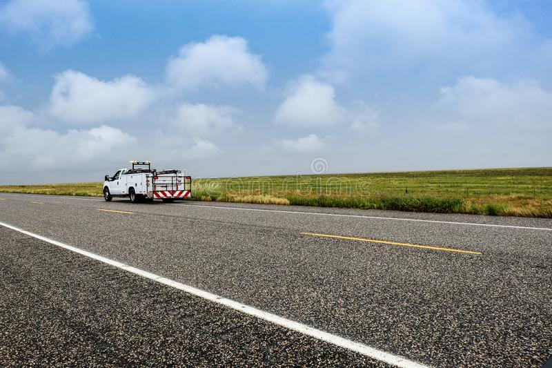 Countryside Road with highway maintenance truck in Colorado, the United States. royalty free stock photo