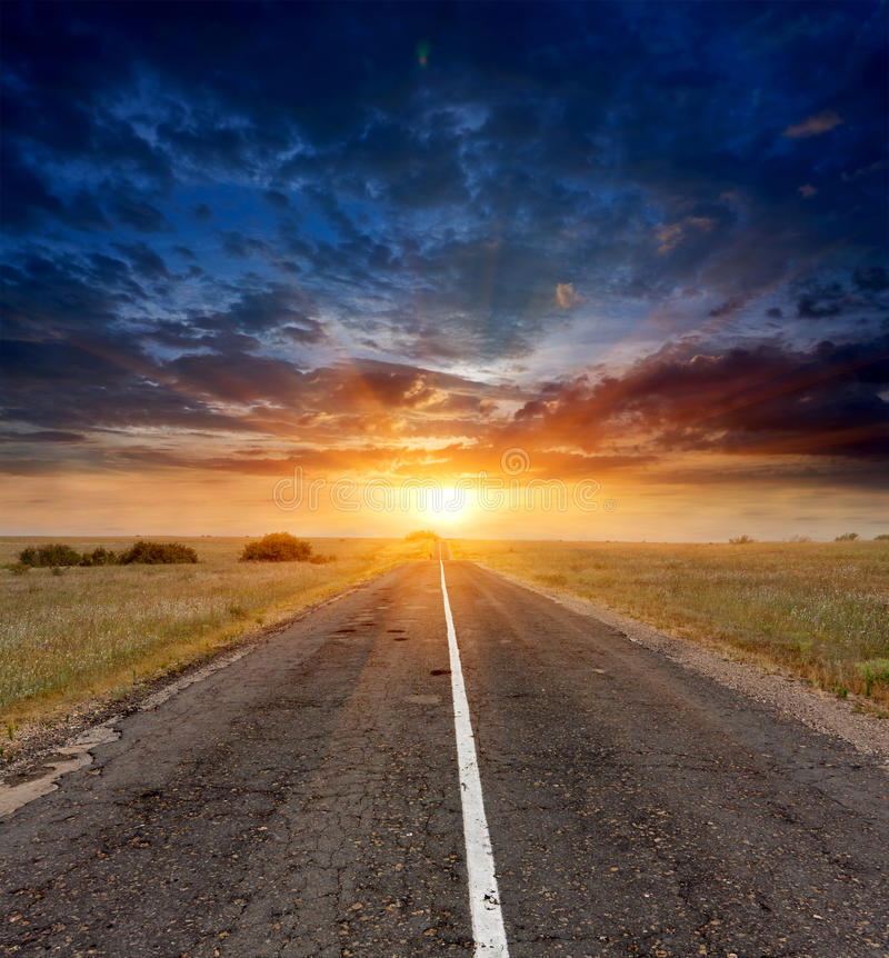 Countryside road on sunset stock images