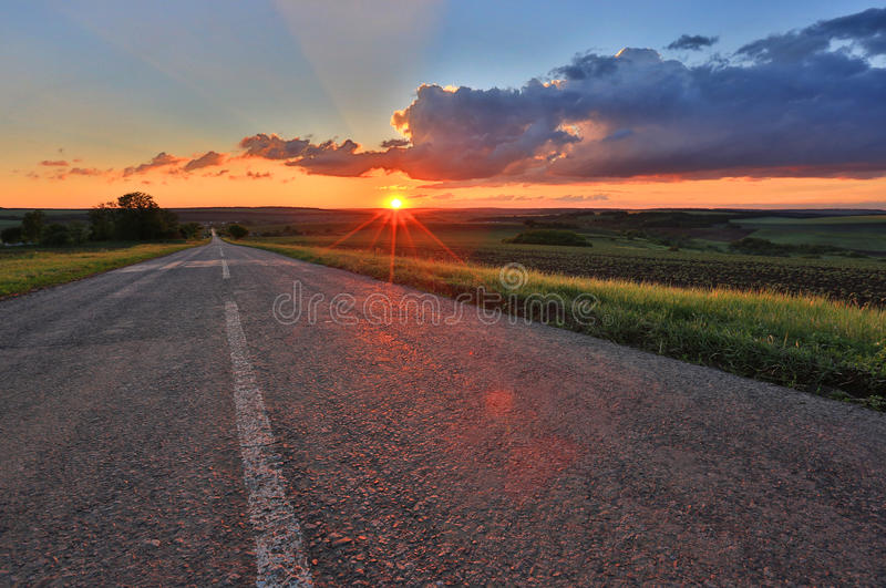 Countryside road on sunset background royalty free stock photo