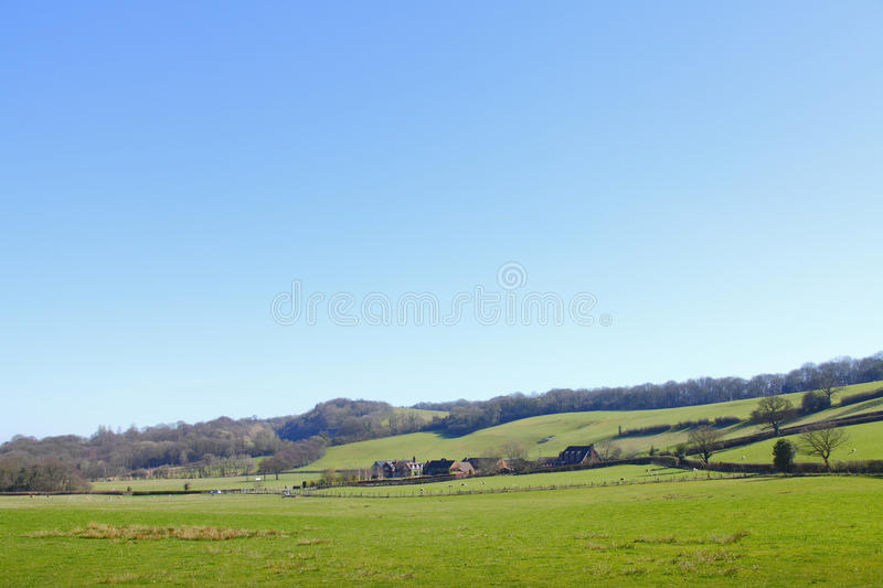 Countryside rural landscape. Green countryside rural farmland landscape royalty free stock photography