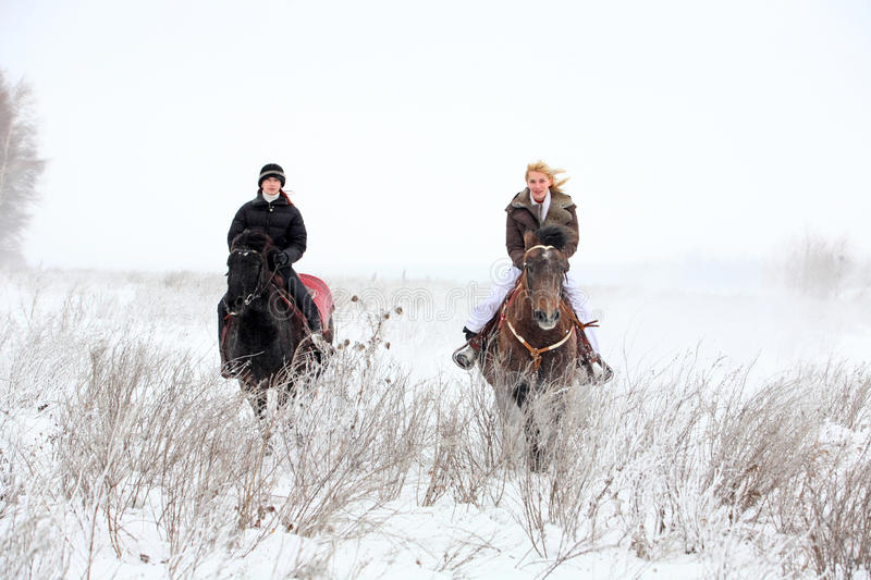 Countryside trail riding in winter evening stock photography