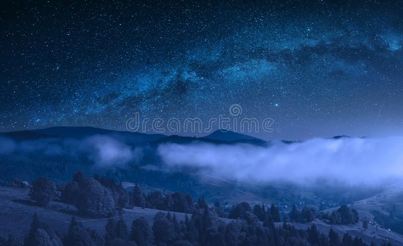 Countryside view of mountain hill at night stock image