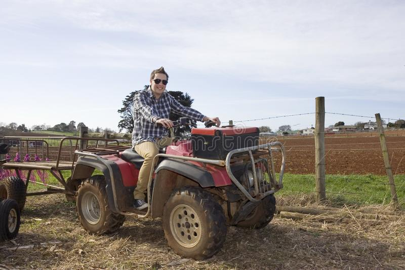 Countryside work vehicle and handsome farmer. royalty free stock photos