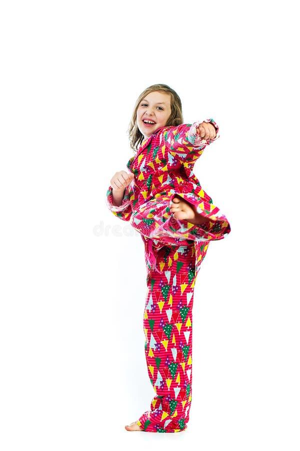 Coup-de-pied de karaté d'enfant photo libre de droits